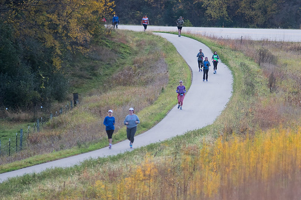 Runners in the Mankato half marathon round the corner on the way to Mt. Kato Sunday. Photo by Jackson Forderer