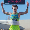 Men's winner Jacob Gallagher crosses the finish line of the Mankato Marathon Sunday. Photo by Jackson Forderer