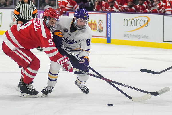 Minnesota State's Parker Tuomie (right) fights through defensive pressure applied by Boston University's Logan Cockerill in a game played on Oct. 12. Photo by Jackson Forderer