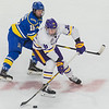 Minnesota State's Ian Scheid passes the puck to a teammate while being defended by Alaska Fairbanks' Troy van Tetering. Sscheid scored two goals for the Mavericks in their 3-1 win to complete the sweep over the Nanooks. Photo by Jackson Forderer