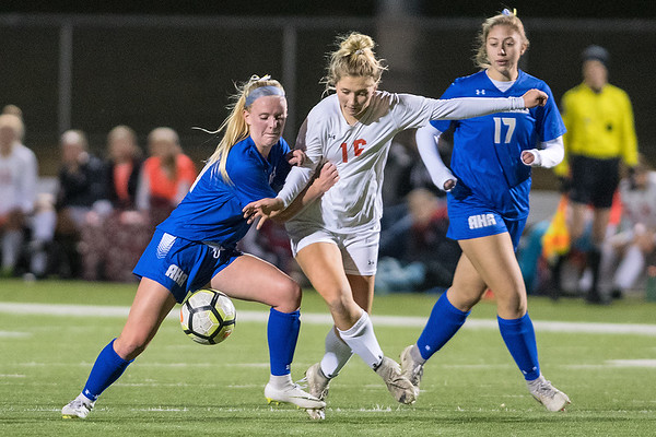 Lexi Peterson of Mankato West is pushed off the ball by Mia Van der Heide of Academy of Holy Angels in the first half of Wednesday's state quarterfinal game. The Scarlets lost to the Stars to bow out of the tournament in the first round. Photo by Jackson Forderer
