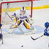 Minnesota State's Mathias Israelsson zeros in on a shot attempt by Alaska Fairbanks' Chris Jandric during Saturday's game played at the Verizon Center. Photo by Jackson Forderer