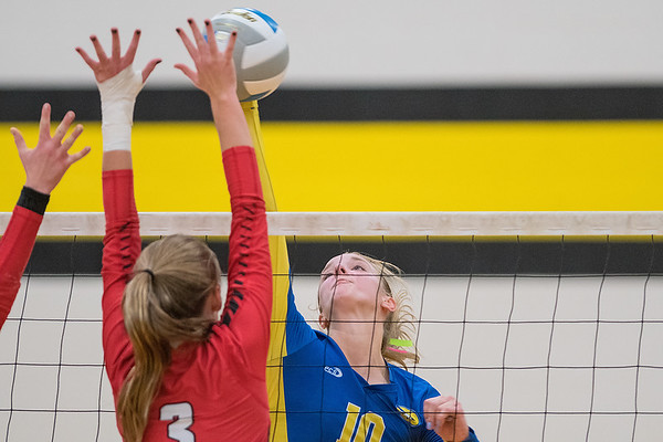 Waseca's Brianna Highum (right) tips the ball past Kenyon-Wanamingo's Julianna Boyum in a Section 2AA playoff game played at Mankato East on Tuesday. The Bluejays took the second game but ultimately fell in four games to the top-ranked Knights. Photo by Jackson Forderer