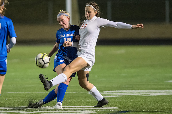 Emma Doell (right) of Mankato West kicks the ball away from Mia Van der Heide of Academy of Holy Angels in the first half of Wednesday's state quarterfinal game. Photo by Jackson Forderer