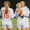 Mankato West's Katie Roberts (15) and Rachel Luedtke console Ashley Gustavson (right) after the Scarlets loss to the Academy of Holy Angels. It was Gustavson's last high school soccer match after playing in the state tournament for three consecutive years. Photo by Jackson Forderer
