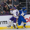 Minnesota State's Nicholas Rivera (left) puts a heavy hit on Alaska Fairbanks' Jordan Muzzillo during Saturday's WCHA conference game played at the Verizon Center. Photo by Jackson Forderer