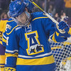 Alaska Fairbanks defensemen James LaDouce looks befuddled as Minnesota State players celebrate their third goal of the game behind him. The Nanooks were held to only six shots on goal as opposed to the Mavericks 26 shots. Photo by Jackson Forderer