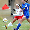 Mankato West's Madison Burandt takes a shot at the goal as Waseca's Ruth Ebertowski chases her down during the first half of their Section 2A tournament game Thursday at the Dakota Meadows fields.