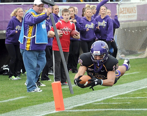 Minnesota State's Andy Pfeiffer dives into the end zone for a touchdown during the first half against Southwest Minnesota State Saturday at Blakeslee Stadium.