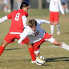 Mankato West's Dillon Lambert (18) is tripped up by Willmar's David Dominguez during the first half of their Section 2A tournament game at the Dakota Meadows fields.