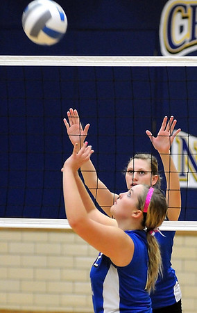 Mankato Loyola's Kelcie Parsons keeps a close eye on Nicollet setter Sara Meurer during their match Thursday at the Fitzgerald gym.