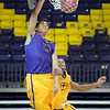 Sophomore center Assem Marei dunks the ball during a team workout Saturday at Bresnan Arena.