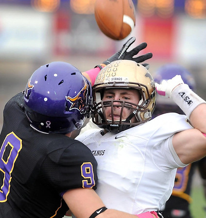 Southwest Minnesota State's Joe Stupka can't avoid colliding with Minnesota State receiver Adam Thielen during the first half Saturday at Blakeslee Stadium, Stupka was called for pass interference on the play.