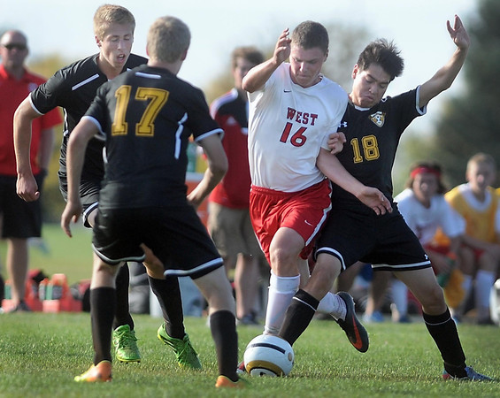 Pat Christman <br /> Mankato West's Matthew Ouren draws a crowd of Hutchinson defenders as he closes in on the net during the first half Thursday at the Dakota Meadows field.