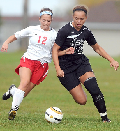 Pat Christman <br /> Mankato West's Rachel Denhof (12) and Mankato East's Rebekah Kolstad collide as they race after the ball during the first half of their Section 2A tournament game Saturday at the Dakota Meadows field.