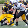 Pat Christman <br /> Gustavus Adolphus College running back Jeff Dubose looks for a way through the St. Thomas defense Saturday.