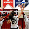 John Cross<br /> Mankato West's Halle Hughes (left) and Megan Hulscher set up to block a tip from Rochester Mayo's Cheyenne Hanson.