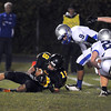 Pat Christman <br /> Mankato East's Mitch Strand recovers a fumble during the early minutes of the second half against Owatonna Friday at Wolverton Field.