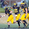 Pat Christman <br /> Gustavus Adolphus College's Lucas Kleinschrodt, left, celebrates with teammates after recovering a St. Thomas fumble during the first half Saturday at Hollingsworth Field.