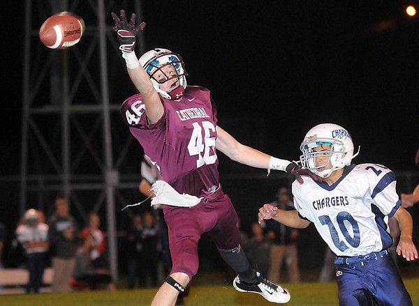 Pat Christman <br /> New Ulm Cathedral's Will Olson can't reach a pass as Minnesota Valley Lutheran's Nate Wong looks on during the first half Friday at Johnson Park in New Ulm.