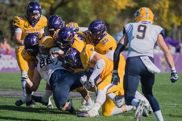 Minnesota State defenders gang tackle Augustana's Brett Shepley (86) during Saturday's game. Photo by Jackson Forderer