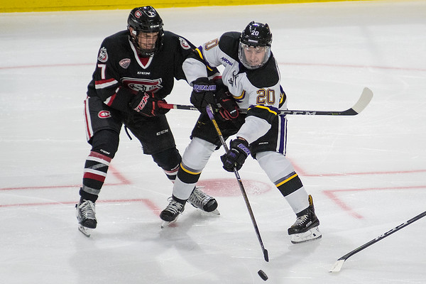 Marc Michaelis (20) of Minnesota State makes a pass to a teammate while being defended by Nick Poehling (7) of St. Cloud State. MSU lost to St. Cloud 3-0 in their home opener. Photo by Jackson Forderer