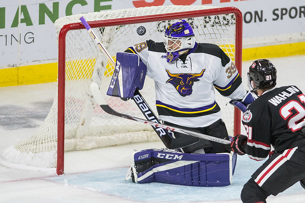 Minnesota State goalie Jason Pawloski makes a pad save against St. Cloud State during Saturday's game. Photo by Jackson Forderer