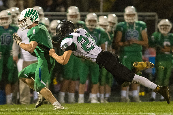 Waterville-Elysian-Morristown's Wyatt Storch dives to tackle Maple River's Lincoln Arndt during Friday's game played in Mapleton. Maple River won the game 25-13. Photo by Jackson Forderer