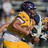 Minnesota State's J.D. Ekowa gives a stiff arm to Augustana's Matt Wagner during Saturday's game played at Blakeslee Stadium. The Mavericks won their homecoming game 42-21 over the Vikings. Photo by Jackson Forderer