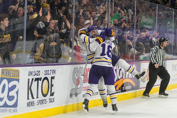 Minnesota State's Charlie Gerard (left) and Ian Scheid (18) celebrate after Gerard's goal in the final seconds of the second period. The goal ended up being the game-winning goal and completed the Maverick's sweep over Boston University. Photo by Jackson Forderer