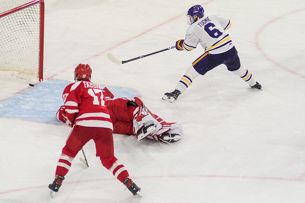 Minnesota State's Parker Tuomie finds the back of the net after faking out Boston University's goaltender Jake Oettinger in the second period. Tuomie scored two goals in the Mavericks 4-3 win. Photo by Jackson Forderer