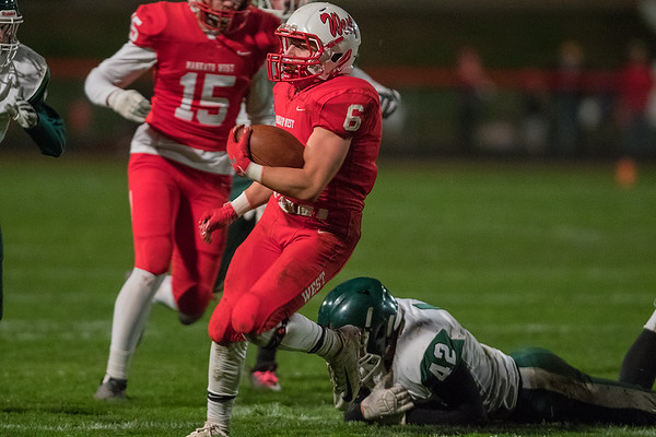 Mankato West's Wyatt Block runs away from a diving tackle attempt by Faribault's Dylan Lippert in the second quarter. Block would score a touchdown on the run, as the West offense jumped out to a big lead over the Falcons. Photo by Jackson Forderer