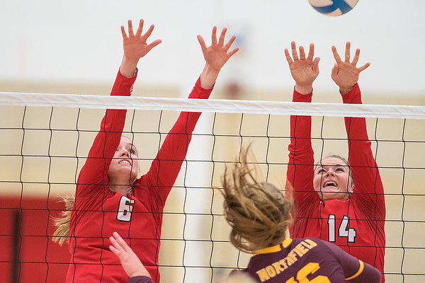 Mankato West's Mattea Burmeister (6) and Kenzie Grunst (14) attempt to block a spike by Northfield's Linnea Larson in Tuesday's Big 9 conference match. Photo by Jackson Forderer