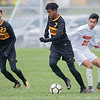 Arafat Hire of Mankato East gets the ball past Marshall's Ivan Celedon in the Cougars Section 2A soccer playoff game. The Cougars won 4-1 to advance to the semifinals of the section tournament. Photo by Jackson Forderer