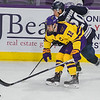 Max Coatta of Minnesota State uses his body to shield the puck away from Luke Simpson of Mount Royal University during an exhibition game played at the Verizon Center on Saturday. Photo by Jackson Forderer