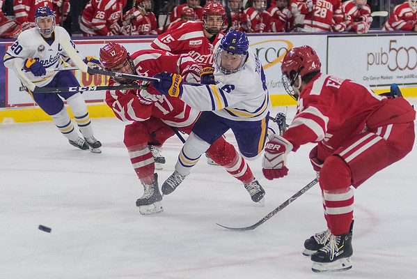 Minnesota State's Parker Tuomie gets hit by Boston University's Dante Fabbro as he took a shot on net in the first period of Saturday's game. The Mavericks completely the sweep with a 5-3 win over the Terriers. Photo by Jackson Forderer