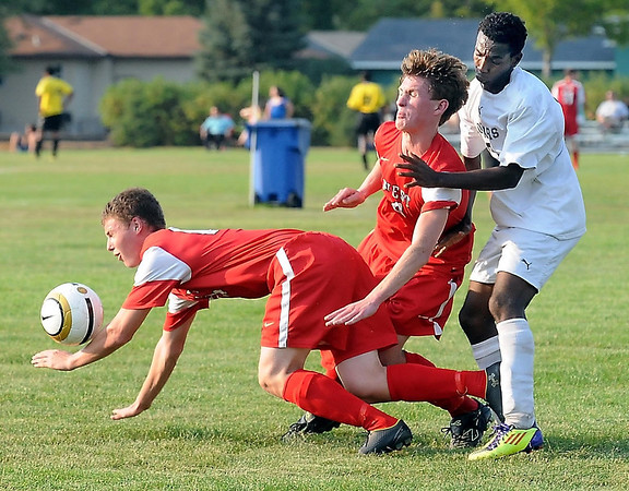 West's Matthew Ouren goes sprawling after tangling legs with teammate Kennedy Maker and East's Mohamud Ahmed.