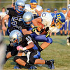 Loyola running back Jacob Klingsporn gets hauled down by a swarm of LCWM defenders.