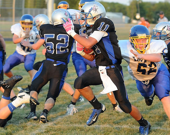 Lake Crystal-Wellcome Memorial's Gabe Gimenez gets by Loyola defender Thomas McDermott after intercepting a pass.