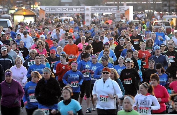 Pat Christman<br /> A mass of runners leave Minnesota State University at the start of the 10K race at Saturday's Mankato Marathon.