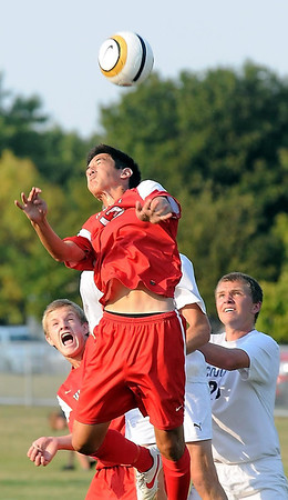 West's William Leitch goes up high to head the ball.