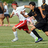 West's Joshua Gish and East's Ricky Cano Hernandez race for the ball during first period action.