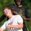 John Cross<br /> East's Anjola Onadipe and West's Matthew Duren go head to head during first period action.
