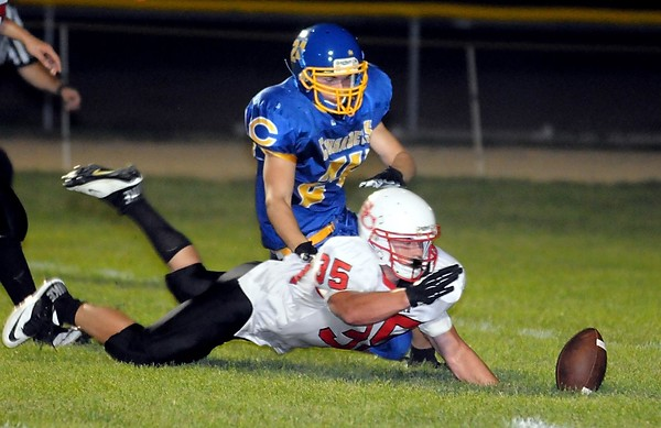 Pat Christman<br /> St. Clair's John Goebel beats Loyola punter Taylor Gross to the ball after blocking a punt in the second half Friday at the Loyola field.