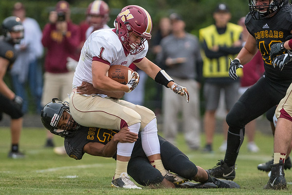 Paul Hampton of Mankato East tackles Northfield's Jim Vitito in the first quarter. Photo by Jackson Forderer