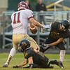 Kawika Hashimoto of Mankato East strips the ball away from Alex Rassmussen (11) of Northfield. Photo by Jackson Forderer