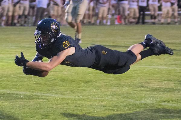 Kyle Sonnek of Mankato East dives into the end zone during the second quarter for the Cougars' first touchdown of the season. East lost to Northfields 31-14 in their first game of the season. Photo by Jackson Forderer