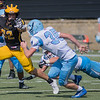 Gustavus' Jamison Beulke puts out a stiff arm for incoming Westminster defender Matthew Tolliver during Saturday's season opener. The Gusties routed the Blue Jays 38-0. Photo by Jackson Forderer