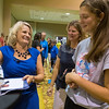 Cindra Kamphoff (left) talks with Alexis Kopischke (right), 16, and Renae Kopischke while signing copies of her new book Beyond Grit at the Verizon Center ballroom on Thursday. Photo by Jackson Forderer