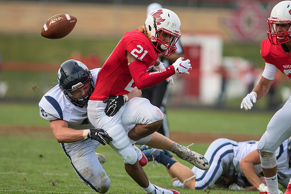 The ball flies loose as Thomas Mergen of Rochester Century tackles Melik Davis of Mankato West. Century recovered the ball, but Davis would help the Scarlets win with a 56-yard touchdown reception. Photo by Jackson Forderer